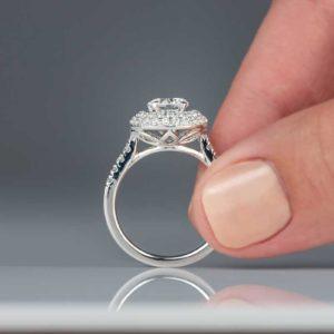 closeup-of-woman-holding-diamond-engagement-ring-9SLBPJU.jpg