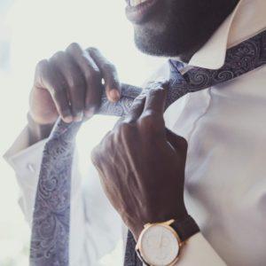 elegant-man-is-dressing-up-near-window.jpg